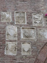 Family Crests on Wall of Buonconvento